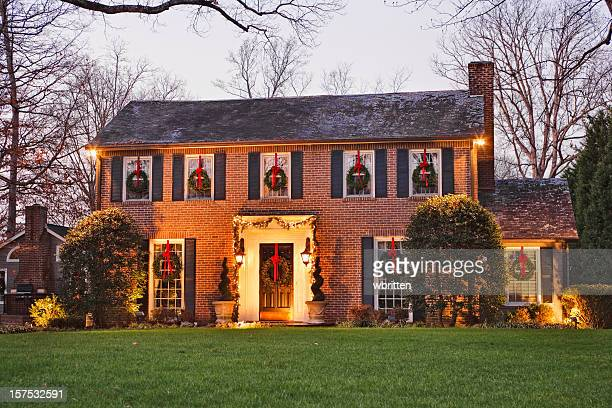 home for christmas at night - christmas decorations stock photos and pictures