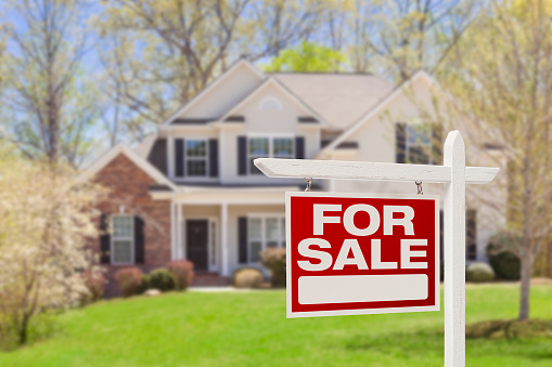 Home For Sale Real Estate Sign and House 177735411