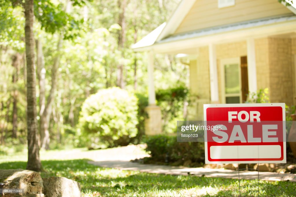 Home for sale with real estate sign. : Stock Photo