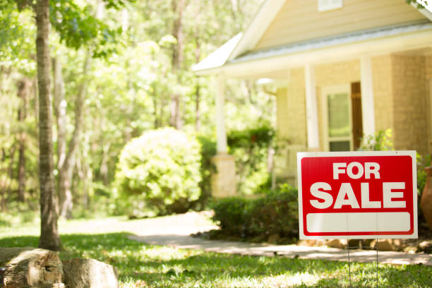 home for sale with real estate sign. - house stock pictures, royalty-free photos & images