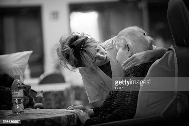 Home For The Aged State nursing home in HauteSavoie France An auxiliary nurse chats to a resident