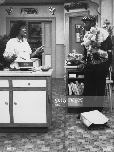"""Home for the Weekend"""" Episode 22 -- Aired 3/17/88 -- Pictured: Phylicia Rashad as Clair Hanks Huxtable, Bill Cosby as Dr. Heathcliff 'Cliff' Huxtable..."""
