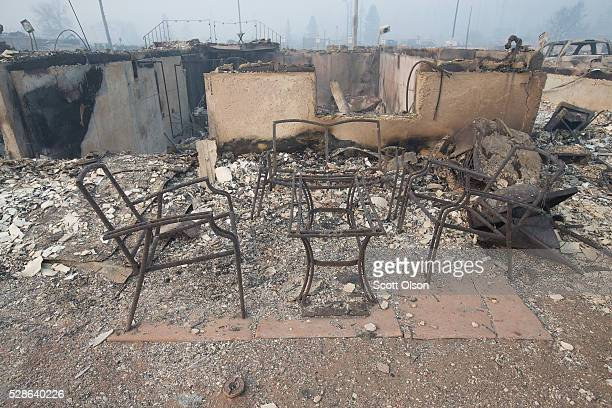 Home foundations and remains of possessions are nearly all that remain in a residential neighborhood destroyed by a wildfire on May 6 2016 in Fort...
