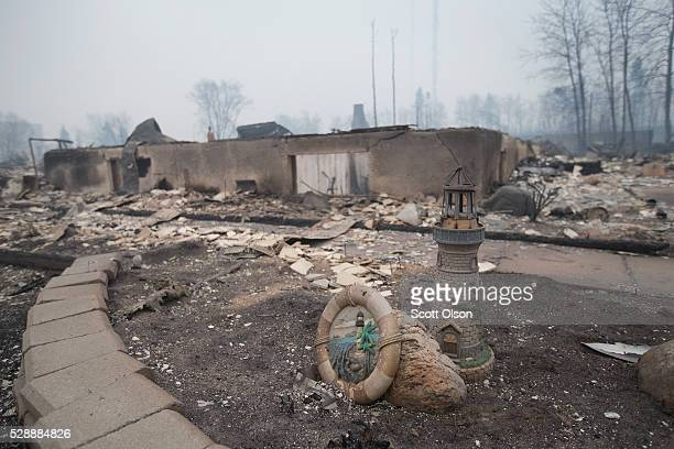 Home foundations and skeletons of possesions are all that remain in parts of a residential neighborhood destroyed by a wildfire on May 7 2016 in Fort...