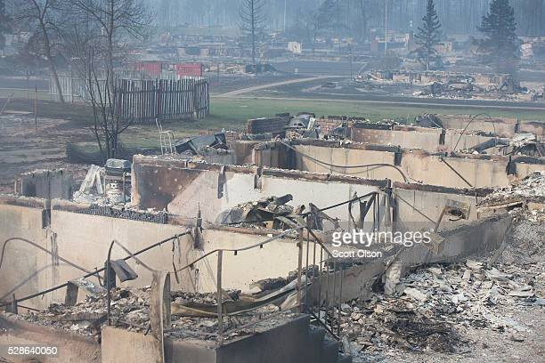 Home foundations are all that remain in a residential neighborhood destroyed by a wildfire on May 6 2016 in Fort McMurray Alberta Canada Wildfires...