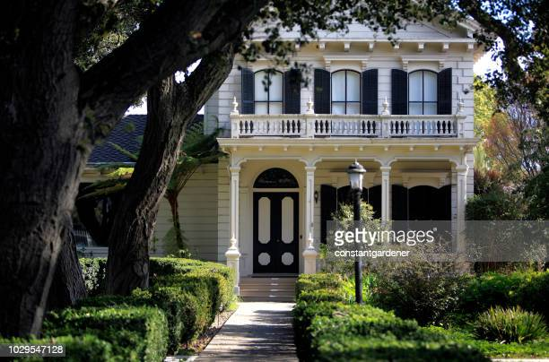 home from a past era with live oaks and boxwood - shutter stock pictures, royalty-free photos & images