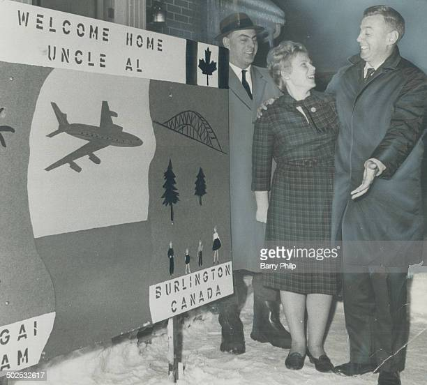 Home from Viet Nam; Dr.; Alje Vennema ; director of Canada's medical mission to Viet Nam for 4 years greets his sister-in-law and brother Gerald at...