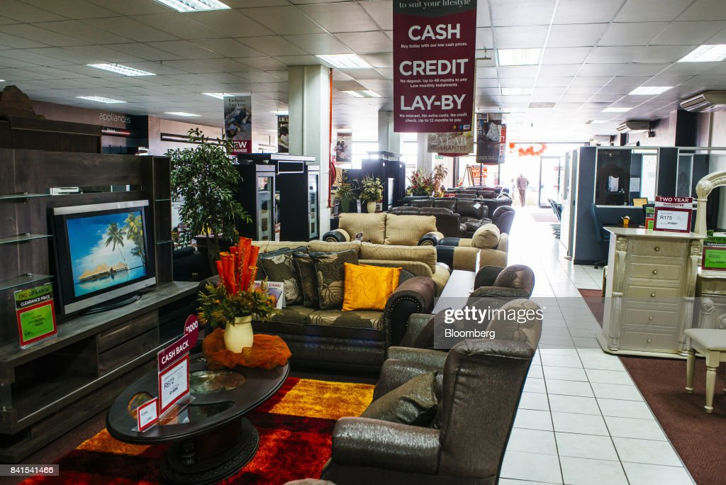Home furnishings including sofas and armchairs sit on display inside a Bradlows store, operated by Steinhoff International Holdings NV, in Johannesburg, South Africa, on Thursday, Aug. 31, 2017. Steinhoffsaid like-for-like sales rose 8 percent as the South African furniture and clothing retailer achieved gains in its core European and African markets. Photographer: Waldo Swiegers/Bloomberg via Getty Images