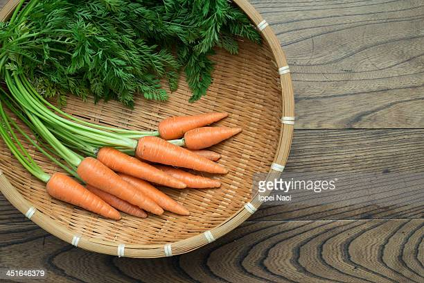 Home grown organic carrots in a bamboo basket