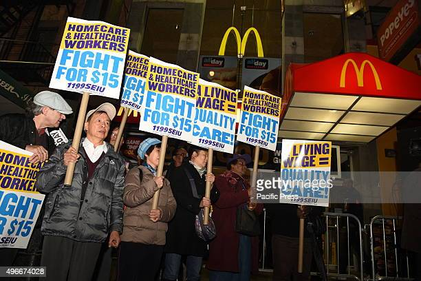 Home health activist with signs array in front of downtown Brooklyn McDonald's Fight for Fifteen's national day of action began with a walkout of...