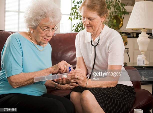 Home healthcare medical professional attends to senior woman.