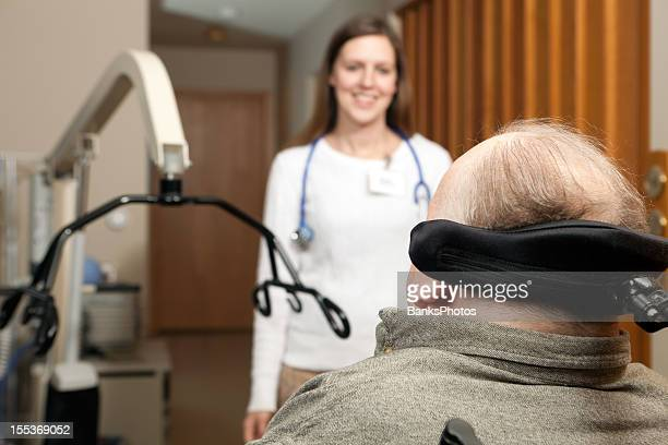 Home Healthcare Nurse Approaches a Patient