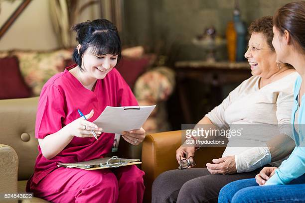 Home healthcare nurse reviews patient information