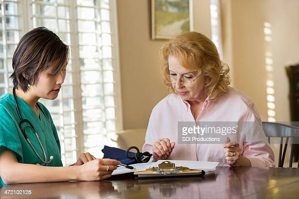 Home healthcare nurse talking with a patient