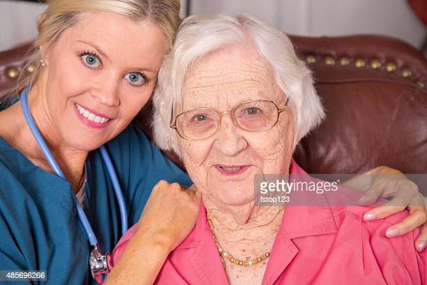 Home healthcare nurse with senior adult patient. House call.