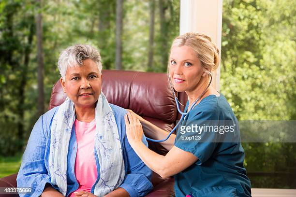 Home healthcare nurse with senior adult patient. Medical exam.