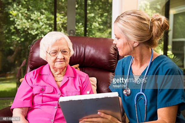 Home healthcare nurse with senior adult patient.