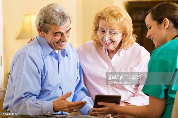 Home healthcare nurse with senior couple