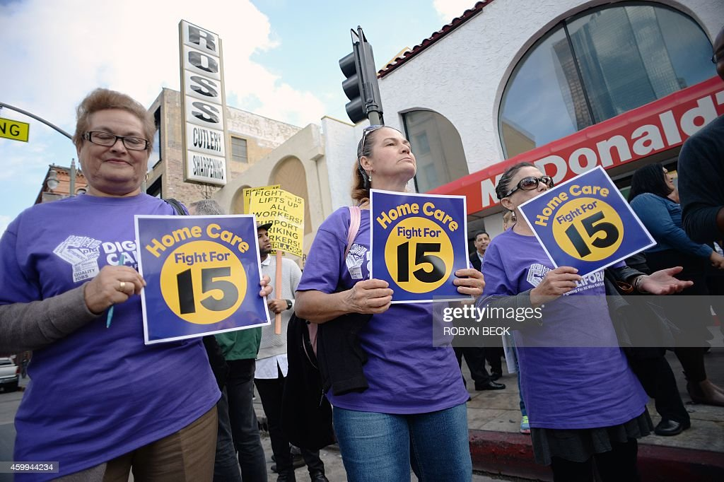Home healthcare workers join fast food workers and their supporter at a rally and march to demand an increase of the minimum wage to 15USD per hour, in Los Angeles on December 4, 2014. The nationwide protest is expected to reach 190 US cities.