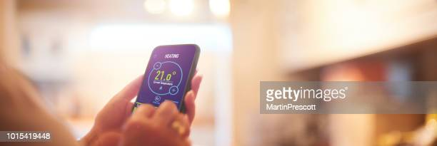 home heating app - energy efficient stock photos and pictures
