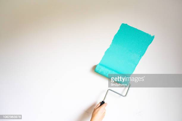 home improvement diy roller painting a wall - paint roller stock pictures, royalty-free photos & images