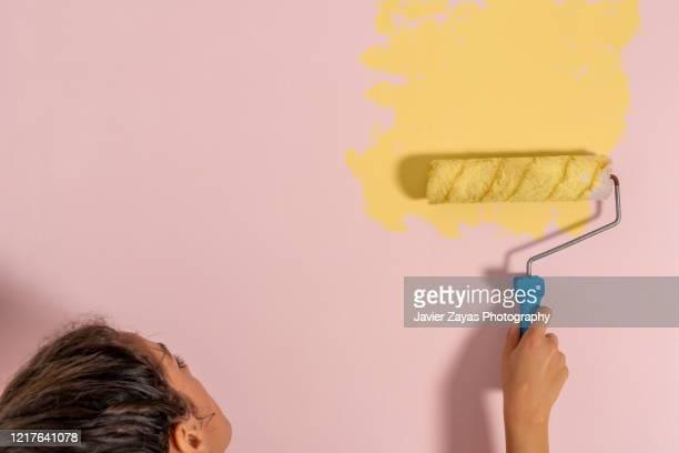 home improvement diy roller painting a wall - decoration stock pictures, royalty-free photos & images
