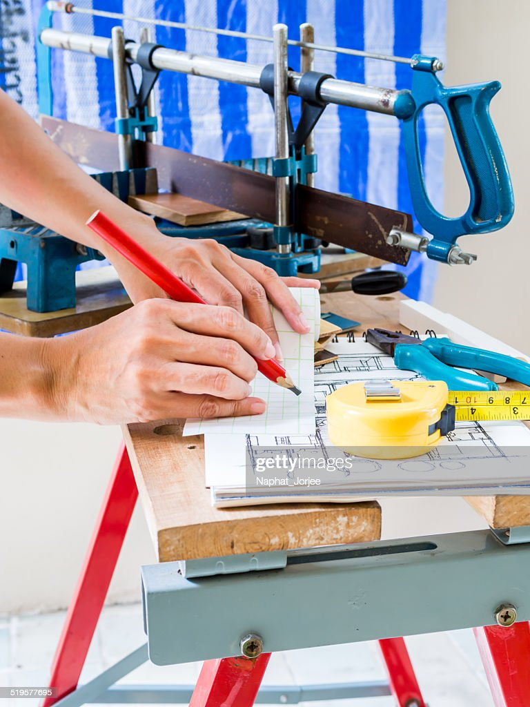 Home Improvement Handyman Working With Woodworking Tools In