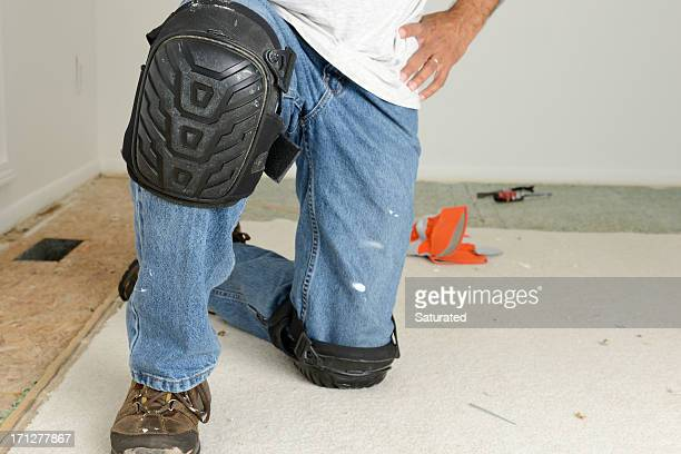 home improvement: kneeling worker's legs with kneepads - padding stock pictures, royalty-free photos & images
