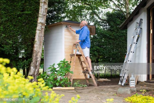home improvement projects - working seniors stock pictures, royalty-free photos & images