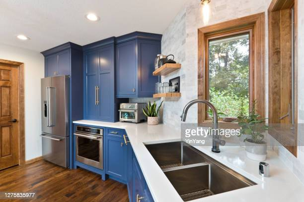 home improvement remodeled contemporary kitchen design - kitchen sink stock pictures, royalty-free photos & images