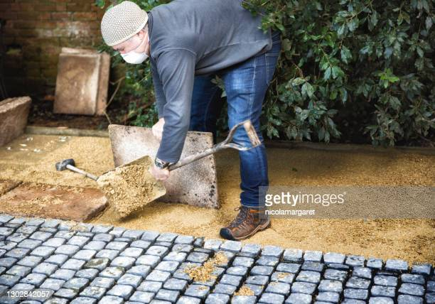 diy home improvement to back yard patio - series - paving stone stock pictures, royalty-free photos & images