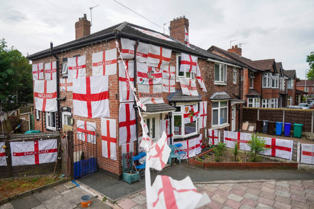 GBR: Manchester Home Festooned In St George Flags For UEFA Euro Tournament