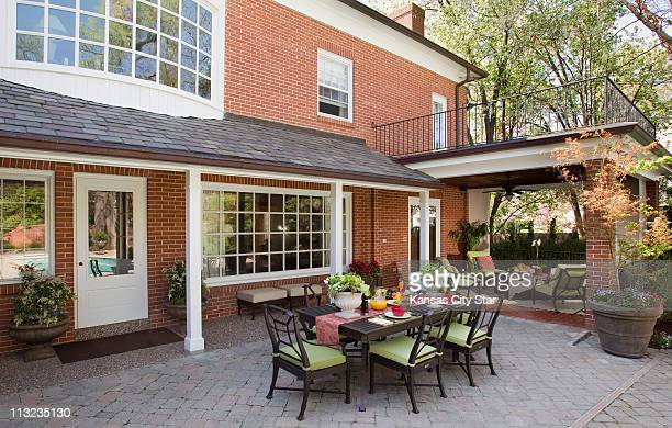 A home in Mission Hills Kansas is shown after a patio makeover transformed the backyard into a showplace