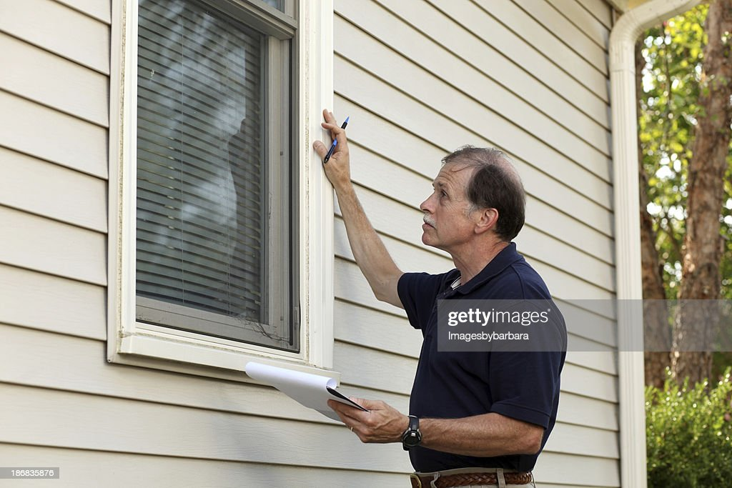 Home inspector checking window frame structure : Stock Photo