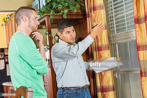 home inspector explaining damage and repairs to homeowner - inspector stock pictures, royalty-free photos & images