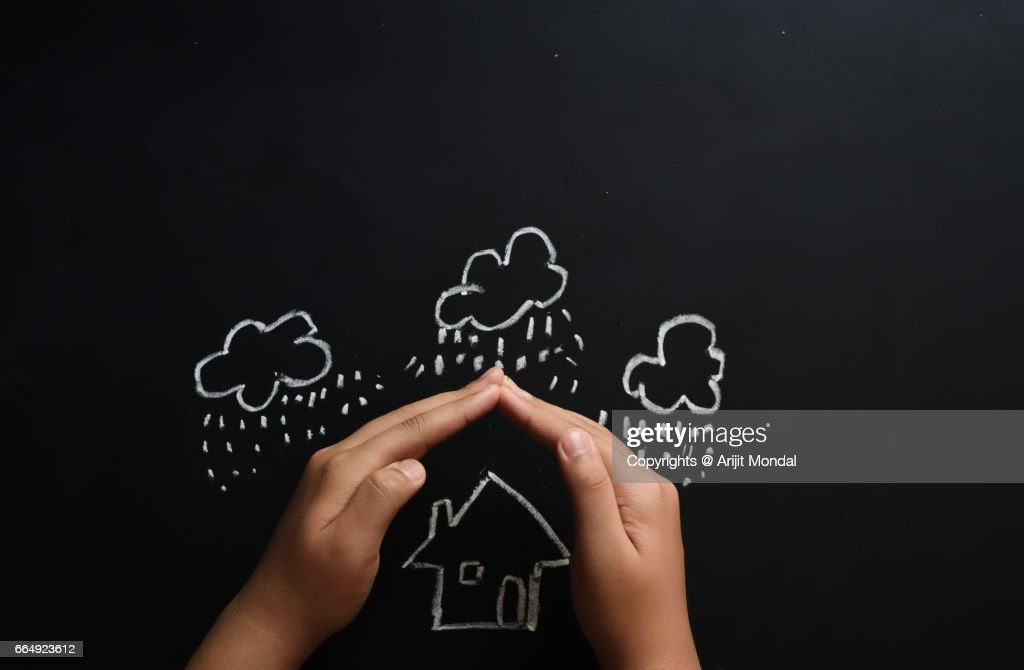 Home Insurance Concept Child Protecting House by Hands with Copy Space : ストックフォト