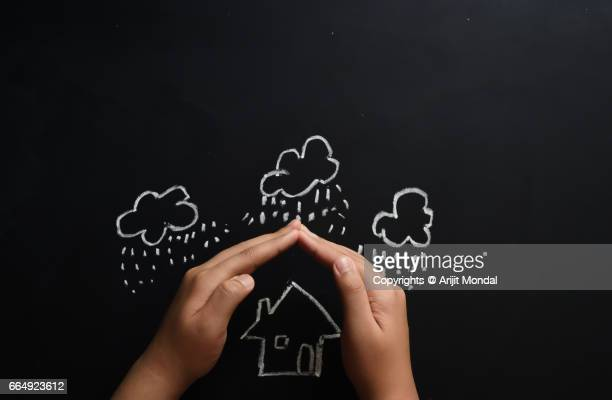 home insurance concept child protecting house by hands with copy space - home insurance stock pictures, royalty-free photos & images