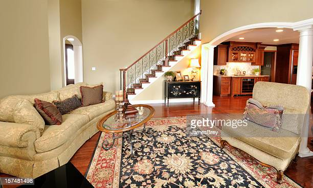 home interior living room, persian rug, pillars, staircase, spacious, open - persian rug stock photos and pictures
