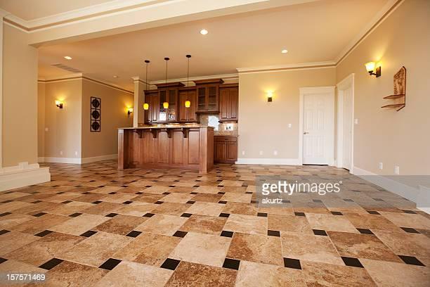 Home interior lower level club room with custom bar