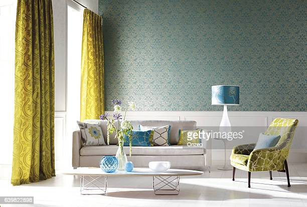 home interior of a contemporary living room with furniture - flower wallpaper stock pictures, royalty-free photos & images