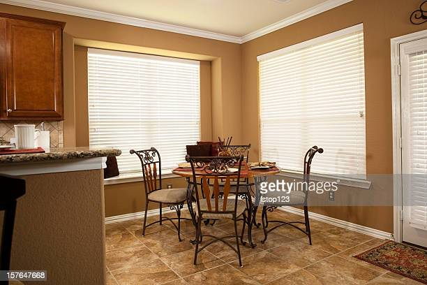 Home interior showing breakfast table, back door and kitchen bar