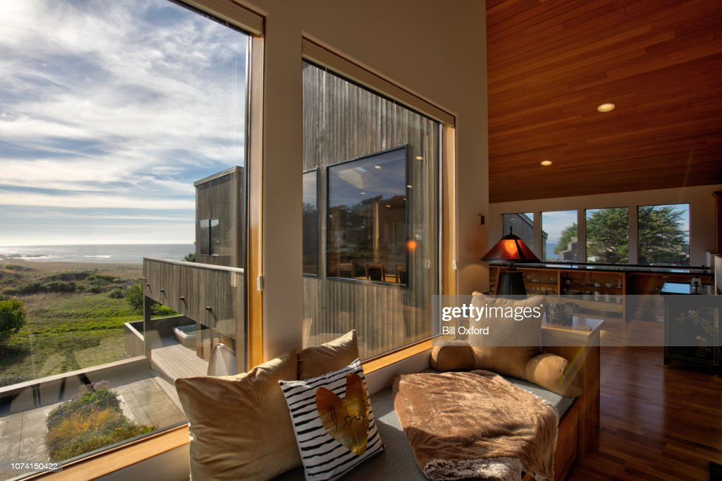 Home Interior: window seat by oceanfront home in California : Stock Photo