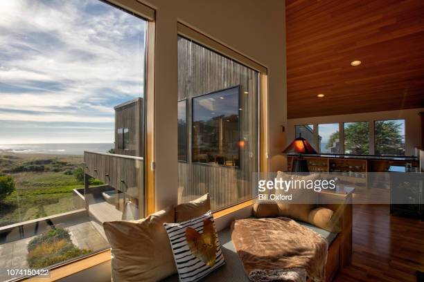 home interior: window seat by oceanfront home in california - waterfront stock pictures, royalty-free photos & images
