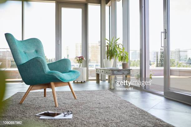 home interior with armchair, tablet and view on roof terrace - carpet decor stock pictures, royalty-free photos & images