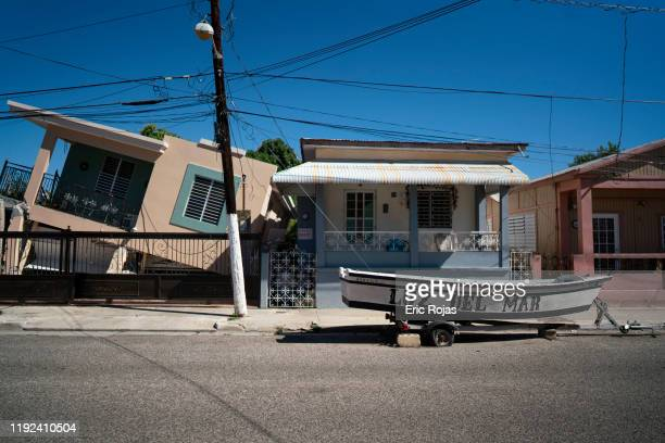 A home is collapsed on one side after a 64 earthquake hit just south of the island on January 7 2020 in Guánica Puerto Rico This morning's earthquake...