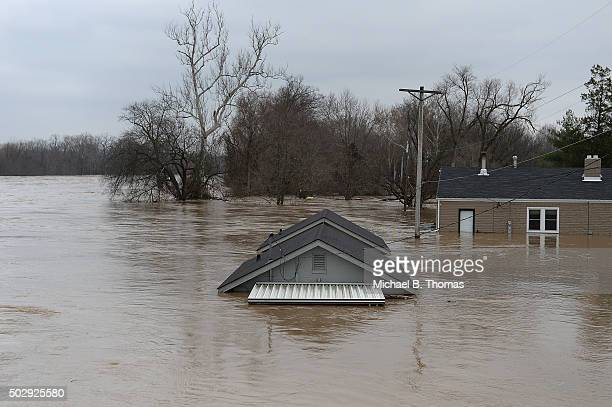 A home is completely submerged on December 30 2015 in Fenton Missouri The St Louis area and surrounding region experiencing record flood crests of...