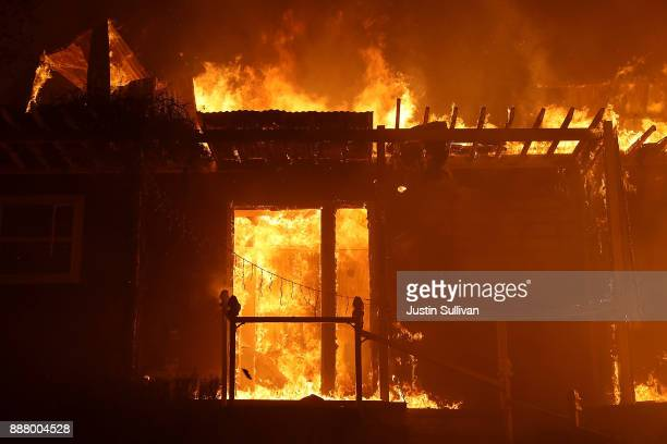 A home is consumed by fire during the Thomas fire on December 7 2017 in Ojai California The Thomas fire has burned over 115000 acres and has...