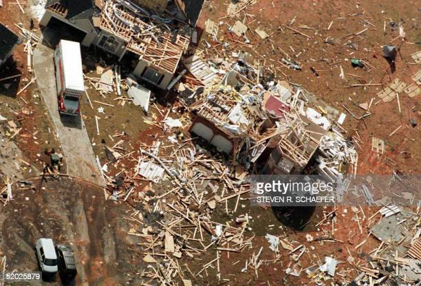 A home is destroyed 09 April in a neighborhood just north of Atlanta GA 09 April after morning tornados caused at least 24 deaths and destroyed homes...