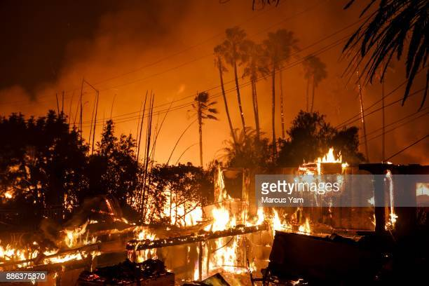 A home is destroyed by brush fire as Santa Ana winds help propel the flames to move quickly through the landscape on December 5 2017 in Ventura...