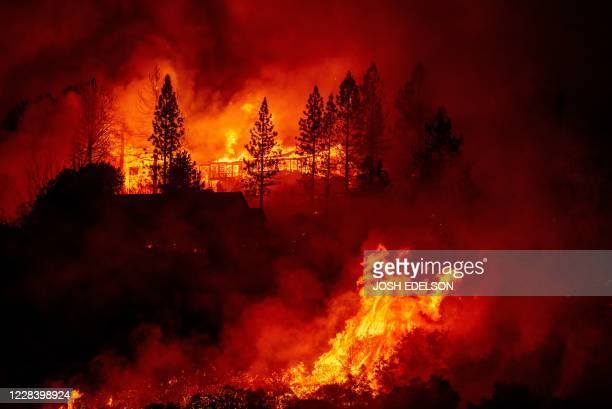 "Home is engulfed in flames during the ""Creek Fire"" in the Tollhouse area of unincorporated Fresno County, California early on September 8, 2020. -..."